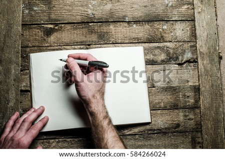 notebook hand with a pen #584266024