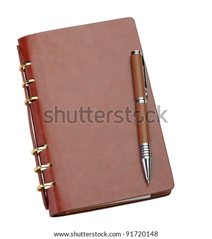 Notebook in a brown leather cover and stylish pen. It is isolated on a white background