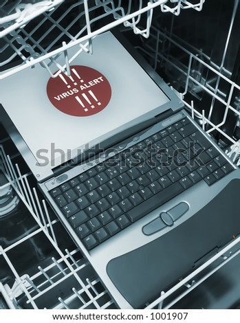 Notebook in dishwasher from above  - virus alert