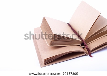Notebook made from recycled paper on white background