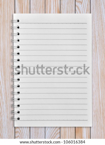 notebook on a wooden background