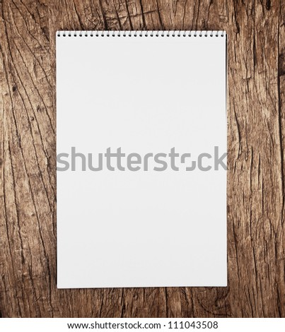 Notebook on a wooden background.