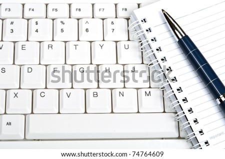 Notebook on an white keyboard