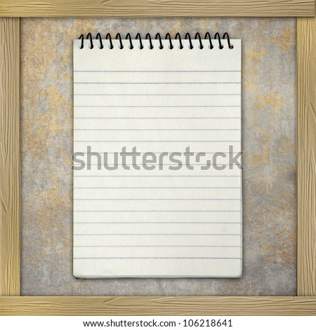 Notebook paper on grunge background