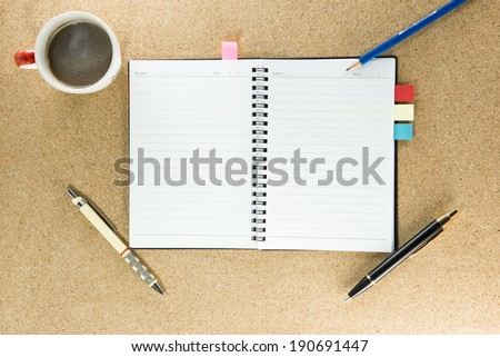 notebook, pen and cup of coffee on work table top view