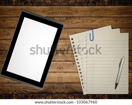 Notebook, pen and tablet pc on wood table background. Business concept
