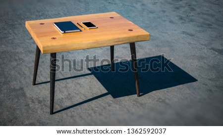Notebook phone and pencil on the loft table. loft furniture