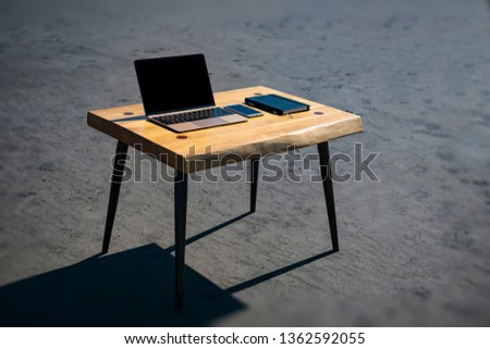 Notebook phone, laptop and pencil on the loft table. loft furniture