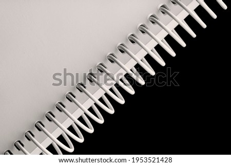 Notebook spiral spines on black background Stockfoto ©
