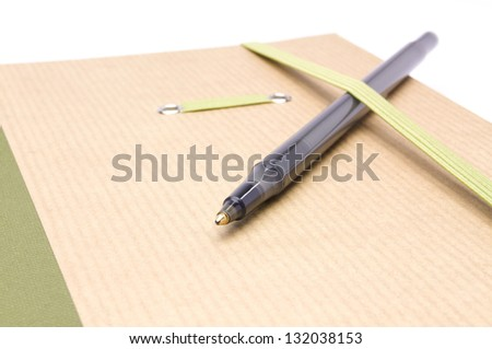 notebook with a pen for notes on a white background