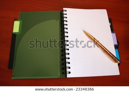 Notebook with golden pen on the table