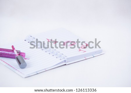 Notebook with I kiss you message written with lipstick
