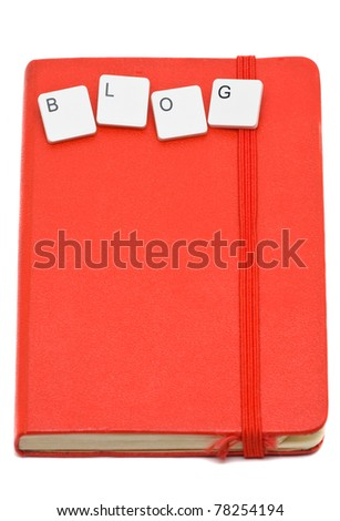 Notebook with keyboard keys spelling 'Blog' over white background