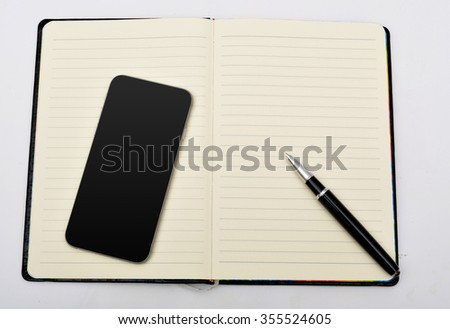 Notebook with pen and smart phone isolated #355524605