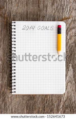 Notebook with pencil and goals of year 2014