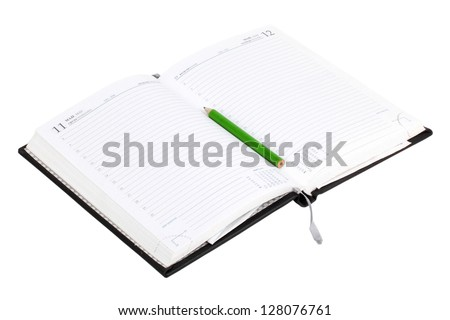 Notebook with pencil isolated on white