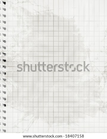 notebook with squares and white paper in it