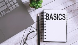 Notebook with Tools and Notes with text BASICS business