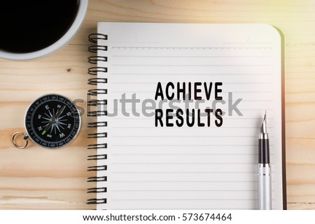 Notebook written with ACHIEVE RESULTS word on wooden background. Business Concept. #573674464