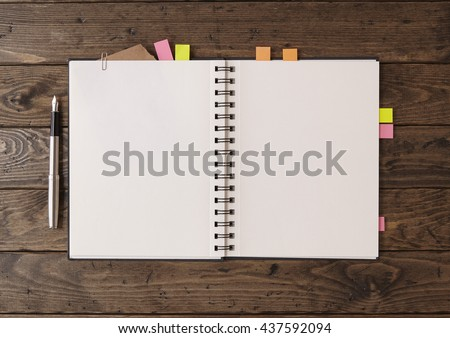 Notebooks and sketch books - A writers / artists journal open on a blank page with book markers and fountain pen, on a rustic wooden desk top to form a revision themed background