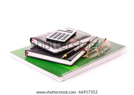 Notebooks, calculator and glasses isolated on white