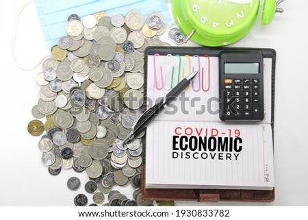 notebooks, pens, bell clocks, face masks and coins with Covid-19 Economic Discovery inscriptions. Stock photo ©