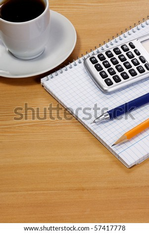 notepad and coffee at table