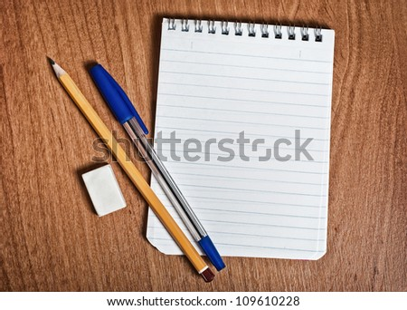 Notepad and pen on the desk