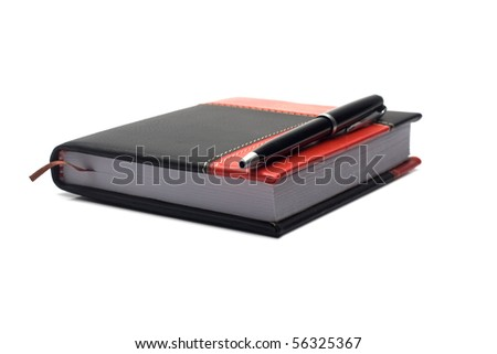 notepad in the red-black cover and pen