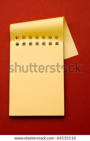 Notepad isolated on the red background