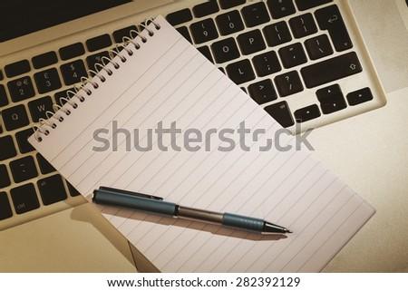 Notepad on laptop on a desk