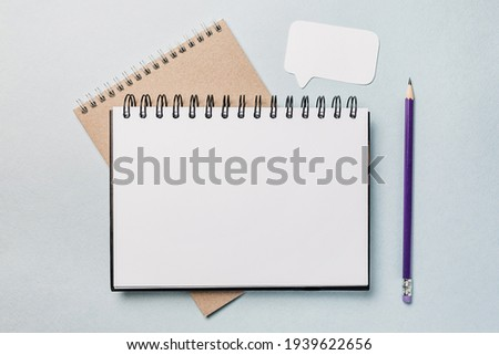 Notepad, white sticker and pensil on the desk. Mock up in copy space office background. It is important not to forget the note Stock photo ©