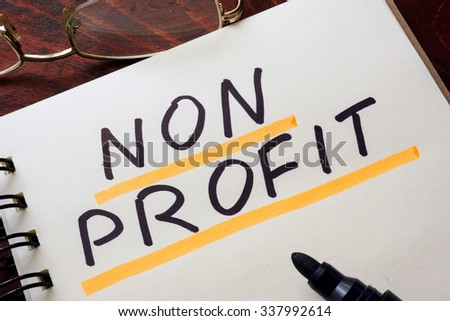 Notepad with non profit   on a table. Business concept.