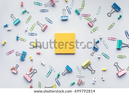 Notepad with set of colorful paper clips on white background.business creativity concepts.Flat lay design
