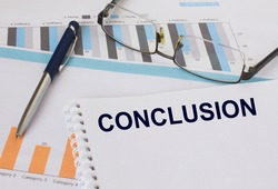 Notepad with text Conclusion lies on financial charts with pen and eyeglass. Financial and business concept