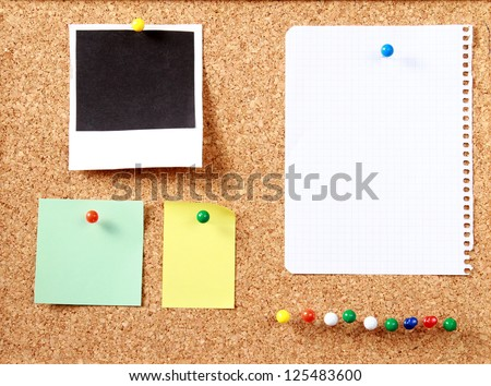 Notes paper and photo card on wooden background
