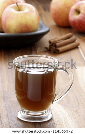 Nothing beats a mug of hot cider on a cold winter day. Apple Cider the coziest drink for autumn, Halloween, Thanksgiving and Christmas. - stock photo