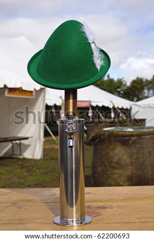 Nothing says Oktoberfest like a white feathered, green felt alpine hat and a draft or beer tap.