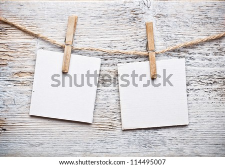 Notice card, white paper and wood clip