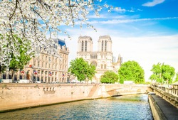 Notre Dame cathedral on Cite island over the Seine river, Paris cityscape at spring, France