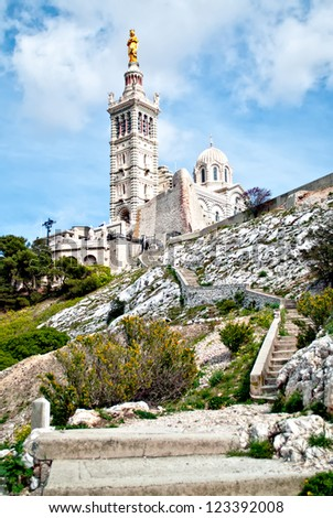 Notre-Dame de la Garde (literally Our Lady of the Guard), is a basilica in Marseille, France. This ornate Neo-Byzantine church is situated at the highest natural point in Marseille.