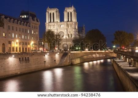 Notre Dame de Paris at dusk; Seine River on Foreground