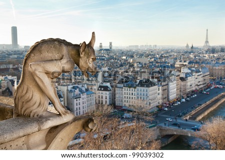 Notre Dame of Paris: Chimera overlooking the skyline of Paris at a sunset - stock photo