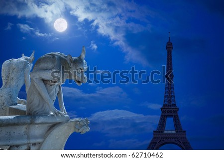 Notre Dame of Paris: Chimeras (demons) looking to the Eiffel Tower under moonlight