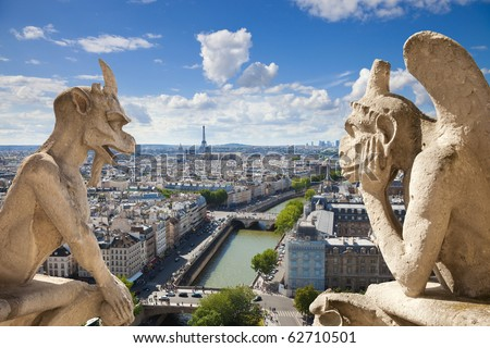 Notre Dame of Paris Stryge and demon most famous of all Chimeras overlooking the skyline of Paris at a summer day composition