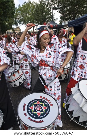 NOTTING HILL, LONDON - AUG 31:  Drummers from Batala Banda de Percussao perform on the streets of London at the Notting Hill Carnival street parade on August 30, 2010 in Notting Hill, London, England