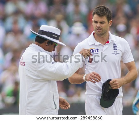 NOTTINGHAM, ENGLAND - July 14, 2013: Aleem Dar and James Anderson during day five of the first Investec Ashes Test match at Trent Bridge Cricket Ground on July 14, 2013 in Nottingham, England.