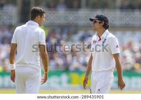 NOTTINGHAM, ENGLAND - July 14, 2013: Steven Finn and Alastair Cook during day five of the first Investec Ashes Test match at Trent Bridge Cricket Ground on July 14, 2013 in Nottingham, England.