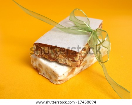 Nougat in two flavors with green ribbon on yellow background