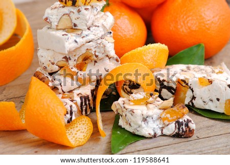 Nougat with nuts, candied orange peels and chocolate. Typical italian sweets.